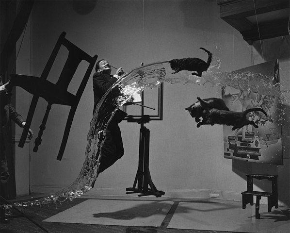 Contoh Karya Aliran Surealisme: Dali Atomicus oleh Salvador Dali, gambar asli diperoleh melalui: wikiart.org
